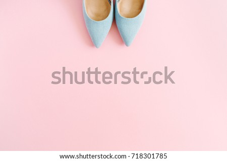 Fashion blog look. Pastel blue women high heel shoes on pink background. Flat lay, top view trendy beauty female background. High heels background.