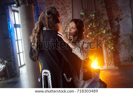 Fine art photo of beautiful girl and monster Royalty-Free Stock Photo #718303489