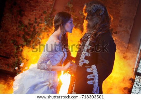 Fine art photo of beautiful girl and monster Royalty-Free Stock Photo #718303501
