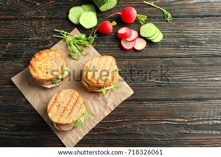 Tasty sandwiches with fresh cucumber on wooden background #718326061
