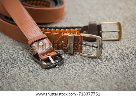 Asian men's vintage belt stylish, placed on a carpeted gray carpet on the floor. Royalty-Free Stock Photo #718377751