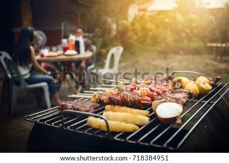 BBQ grill with pork and vegetable on fire and smoke vintage tone of picture.