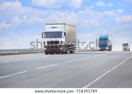 trucks goes on highway in evening on sunset #718393789