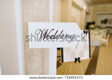 Wedding. Wedding decor. Wooden plaque with the inscription Wedding. #718401673