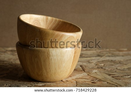 Pile empty wood bowl on rustic wooden background. #718429228