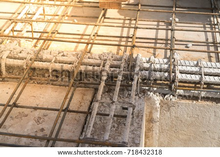 Rebar steel reinforcement in beam concrete structure of  home building #718432318