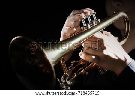 Trumpet instrument. Music player trumpeter jazz playing. Brass instrument cornet hands Royalty-Free Stock Photo #718455715