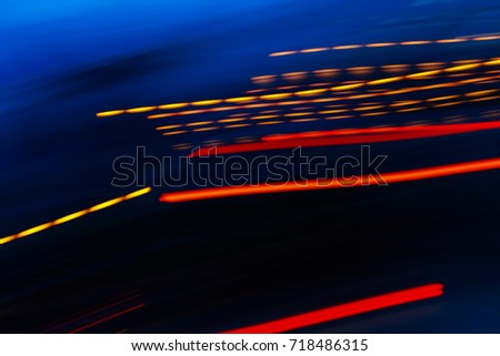 Abstract motion blur of multicolor night light on a black background. #718486315