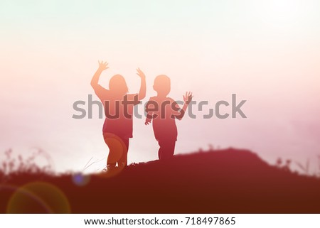 silhouette of a happy children and happy time sunset #718497865