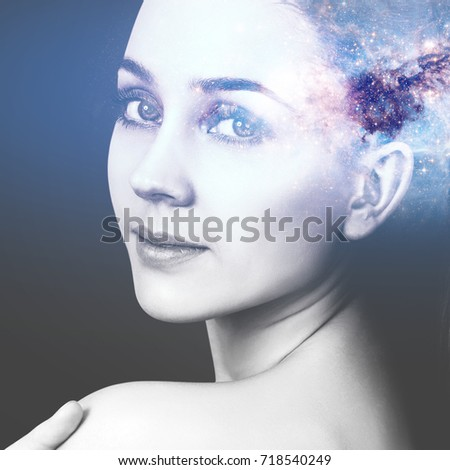 Abstract image of woman face and cosmic galaxy. #718540249