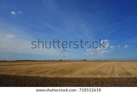 wind turbines on a field in Puglia, Italy #718552618