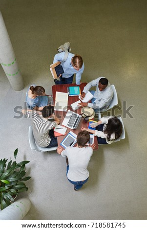 Students as team in a meeting discussing in teamwork in university #718581745