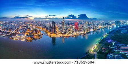 Royalty high quality free stock image aerial view of Ho Chi Minh city, Vietnam. Beauty skyscrapers along river light smooth down urban development in Ho Chi Minh City, Vietnam.  #718619584