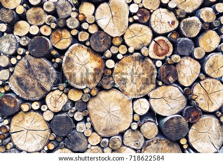 Stack of sawn logs. Natural wooden decor background. #718622584