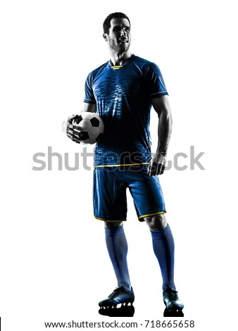 one caucasian soccer player man standing in silhouette isolated on white background #718665658