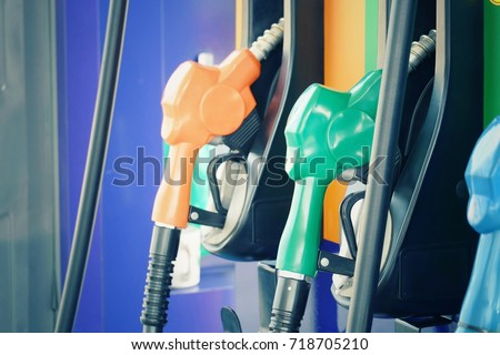 close up nozzle fuel in gas station, transport and business concept, process vintage tone #718705210
