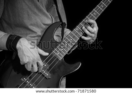 man playing electrical bass-guitar, black and white #71871580