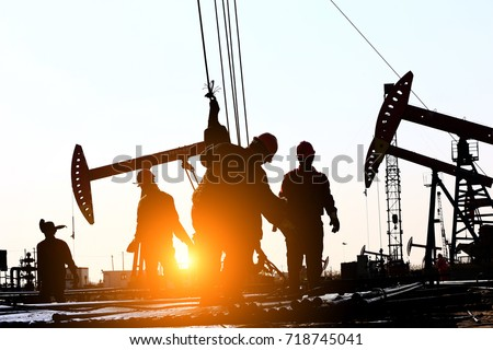The oil workers at work #718745041
