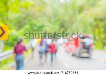image of blur people walking on street with sunny day in green forest for background usage . #718752334