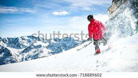 winter time in alps and skier  #718889602