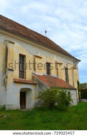 Fortified medieval saxon church in the village Barcut, Bekokten, Brekolten, Transylvania,Romania #719025457