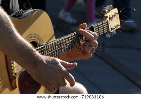 The hands of guitar playing man.  #719031106