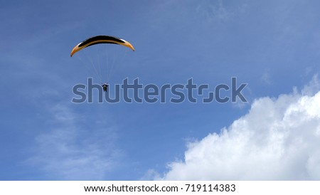 Paragliding in blue sky  #719114383