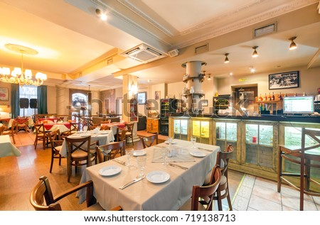 MOSCOW - AUGUST 2014: The restaurant's interior is home to the Armenian and Caucasian cuisine - Gayanes. Hall with a bar and served tables #719138713