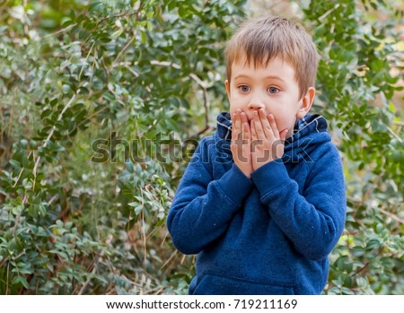 A scared closeup facial expression of a Caucasian child. Afraid of punishment, bad behavior, severe punishment, grounded, scared kid, caught on lie, overwhelmed child, overwhelming stock image.