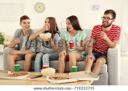 Friends watching TV at home #719233735