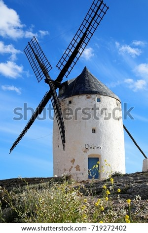 Isolated windmill stands quietly on the hill and enjoys sunbath of a good weather day, Consuegra, Central Spain #719272402