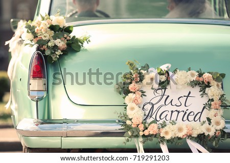 Beautiful wedding car with plate JUST MARRIED Royalty-Free Stock Photo #719291203