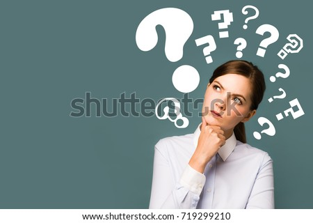 young woman with question marks.