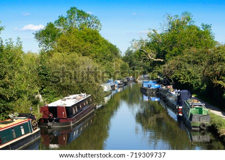 Rows of riverboats moored near Newbury, UK #719309737