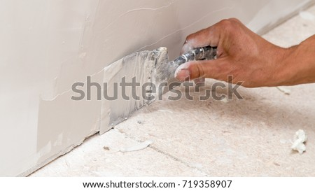 the worker plastered the mortar on the wall #719358907
