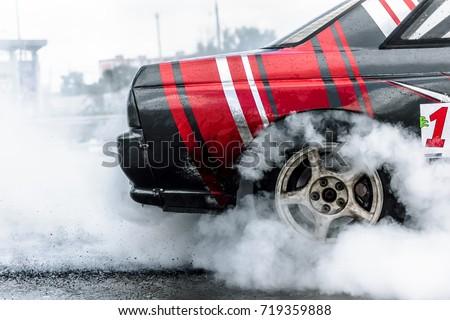 racing car drift in smoke of rubber #719359888