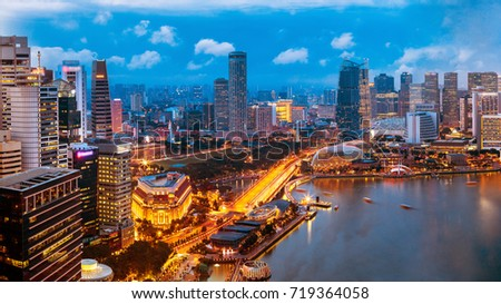 Singapore cityscape at dusk. Landscape of Singapore business building around Marina bay. Modern high building in business district area at twilight. #719364058