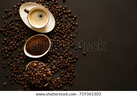 Espresso, beans and ground coffee on brown wooden background. Top view. Space for copy #719365303