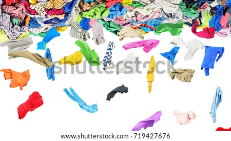 Separate clothing fall from a large pile of clothes on a white background #719427676