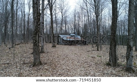 Rustic Old Maple Syrup Shack In The Woods In Early Spring #719451850