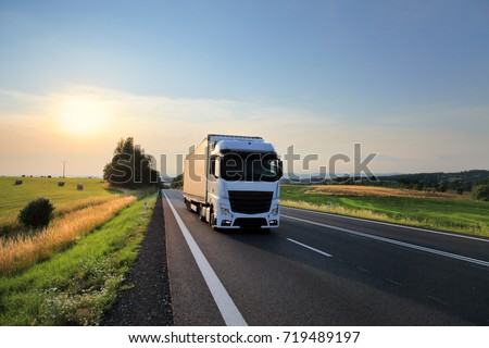 Truck transportation at sunset #719489197