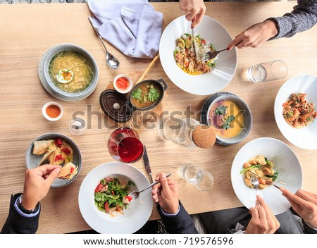 Happy family dinning at home, cozy atmosphere, happy friends celebrating at restaurant with mediterranean kitchen, top view of festive table pastel #719576596