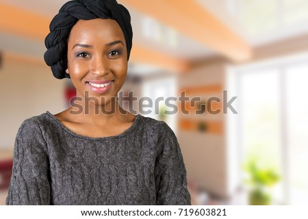 portrait of happy african american woman #719603821