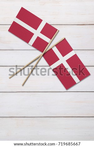 Two flags on a painted wood background #719685667