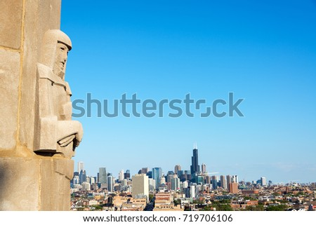 Art deco statue with downtown Chicago in the background