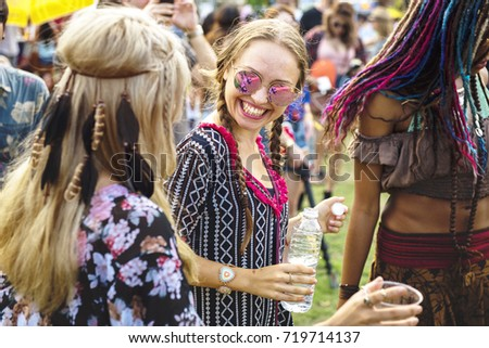 Group of Friends Drinking Beers Enjoying Music Festival together #719714137