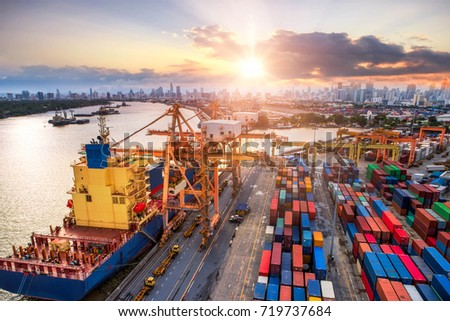 Logistics and transportation of Container Cargo ship and Cargo plane with working crane bridge in shipyard at sunrise, logistic import export and transport industry background #719737684