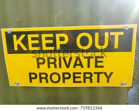 """A sign that reads """"keep out - private property"""". #719812366"""