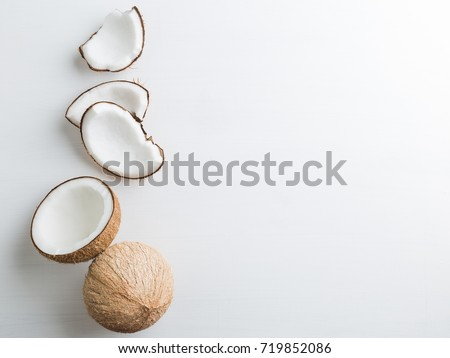 Tropical fruit whole and half abstract background .Coconut on white background. from top view #719852086