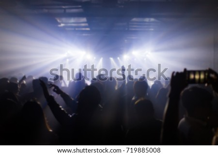 Effects blur Concert, disco dj party. People with hands up having fun #719885008